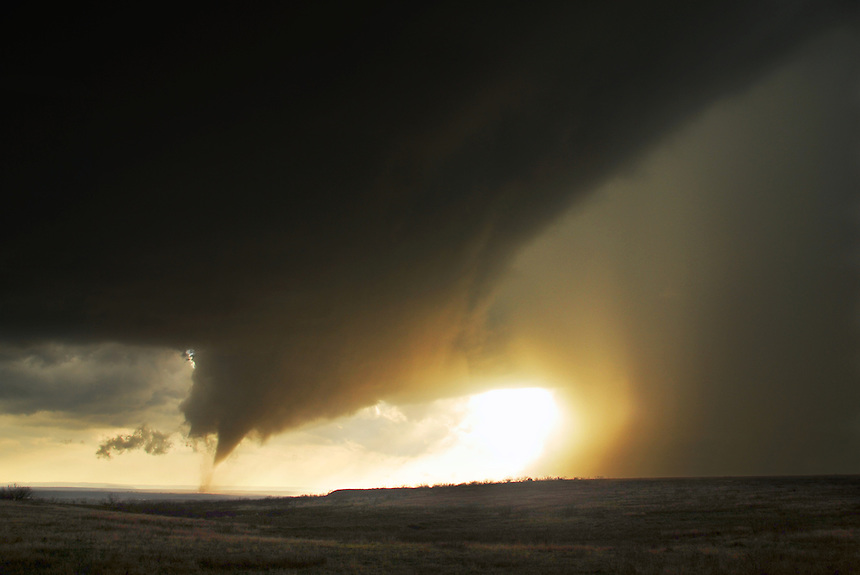 A dramatic wide-angle view of a large and strong tornado near sunset just north of the Palo Duro Canyon in the Texas Panhandle on March 28th, 2007.