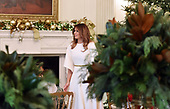 First Lady Melania Trump participates in arts and crafts projects with children and students from Joint Base Andrews in the State Dining Room of the White House in Washington, DC, November 27, 2017.<br /> Credit: Olivier Douliery / Pool via CNP