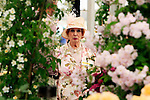 29/06/2015<br /> <br /> RHS Hampton Court Palace Flower Show prepares to open to the public.<br /> <br /> A lady in a floral outfit enjoys the Festival of Roses tent.
