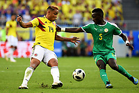 SAMARA - RUSIA, 28-06-2018: Idrissa Gana GUEYE (Der) jugador de Senegal disputa el balón con Luis MURIEL (Izq) jugador de Colombia durante partido de la primera fase, Grupo H, por la Copa Mundial de la FIFA Rusia 2018 jugado en el estadio Samara Arena en Samara, Rusia. /  Idrissa Gana GUEYE (R) player of Senegal fights the ball with Luis MURIEL (L) player of Colombia during match of the first phase, Group H, for the FIFA World Cup Russia 2018 played at Samara Arena stadium in Samara, Russia. Photo: VizzorImage / Julian Medina / Cont