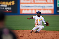 Michigan Wolverines second baseman Ako Thomas (4) flips the ball to second base after making a diving stop during a game against Army West Point on February 18, 2018 at Tradition Field in St. Lucie, Florida.  Michigan defeated Army 7-3.  (Mike Janes/Four Seam Images)