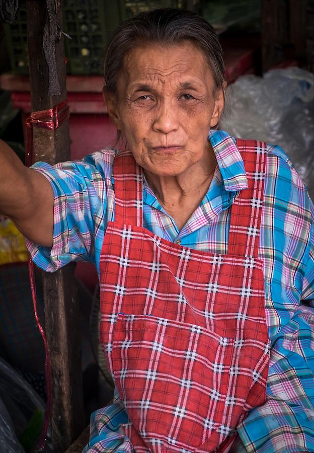 MAE KLONG - TAHILAND - CIRCA SEPTEMBER 2014: Portrait of Thai woman, a merchant of the Maeklong Railway Market