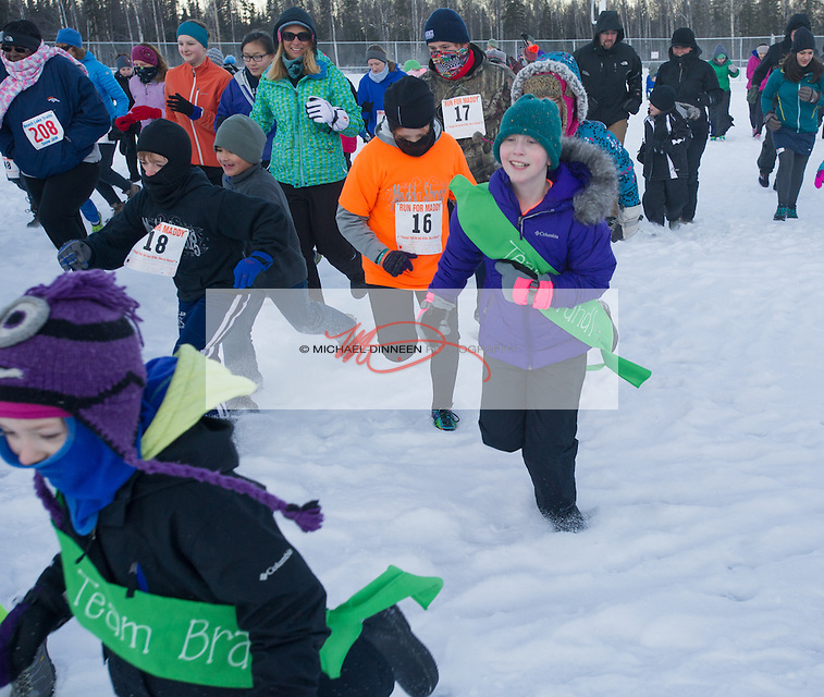 Maddy Brandle (in green sash) participates in the 5k run at Eagle River High School.  Photo for the Star by Michael Dinneen