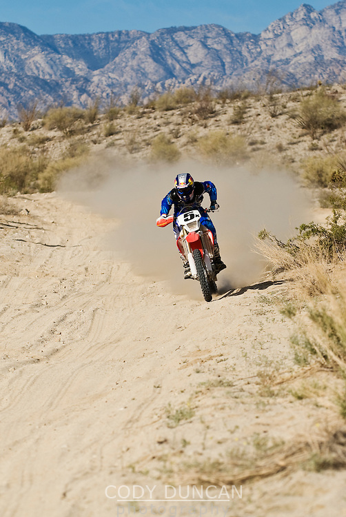 #5 Honda motorcycle riden by Steve Hengeveld speeds through desert of Baja California, Mexico. 2008 San Felipe Baja 250