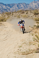 #5 Honda motorcycle riden by Steve Hengeveld speeds through desert of Baja California, Mexico. 2008 San Felipe Baja 250