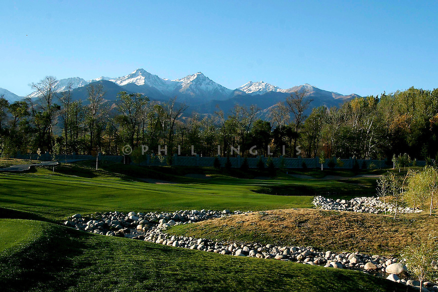 The Tien-Shan mountain range provide a backdrop to the 17th hole par 3 at Zhailjau Golf Resort, Almaty, Kazakhstan. Designed by Arnold Palmer. Picture Credit/ Phil Inglis