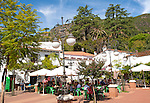 People gathered outside a cafe at Sunday lunchtime  village of Alajar, Sierra de Aracena, Huelva province, Spain