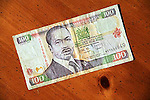 Kenya 100 shilling currency bills on table