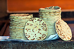 Large tortillas are stacked for eating at a coffee farm kitchen in western El Salvador.