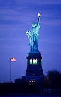 Statue of Liberty and stars and stripes at twilight