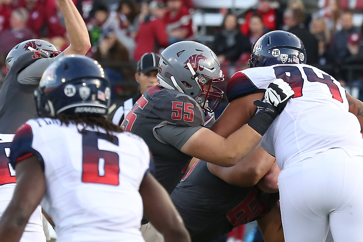 Noah Osur-Myers (55), Washington State offensive lineman, blocks for his quarterback during the Cougars Pac-12 Conference demolition of the Arizona Wildcats, 69-7, on November 5, 2016, at Martin Stadium in Pullman, Washington.