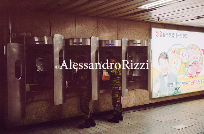 Army man on the public phone