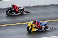 Oct. 8, 2012; Mohnton, PA, USA: NHRA pro stock motorcycle rider Scotty Pollacheck (near lane) races alongside Matt Smith during the Auto Plus Nationals at Maple Grove Raceway. Mandatory Credit: Mark J. Rebilas-