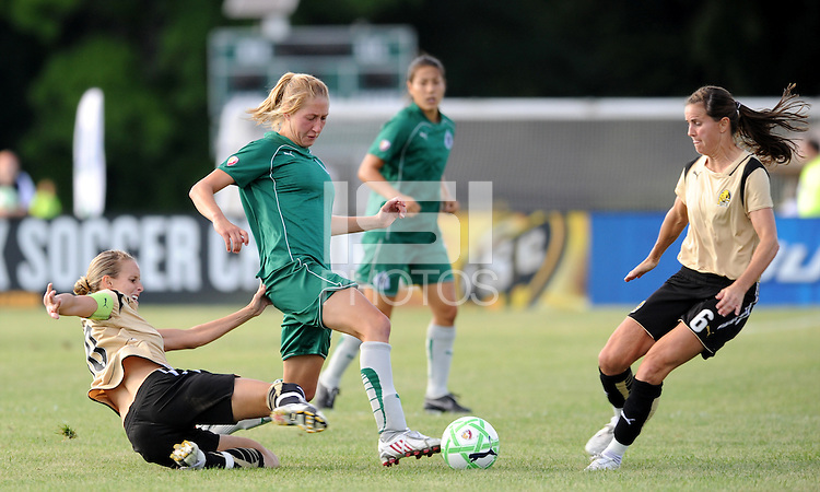 Amanda Cinalli (green) evades the tackle of Leslie Osborne...Saint Louis Athletica tied FC Gold Pride 1-1, at Anheuser-Busch Soccer Park, Fenton, MO.