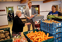 14 May 2019 - Prince Harry Duke of Sussex, looks at produce as he visits a food bank during a visit to Barton Neighbourhood Centre in Oxford. The centre is a hub for local residents which houses a doctor's surgery, food bank, cafe and youth club. Photo Credit: ALPR/AdMedia