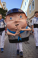 "Spain. Balearic Islands. Minorca (Menorca). Mahon. The parade of the Giants in the ""Festes de la Mare de Déu de Gràcia"" during the traditional summer festival. A young boy plays the flute. Maó (in Catalan) and Mahón (in Spanish), written in English as Mahon, is a municipality, the capital city of the island of Menorca, and seat of the Island Council of Menorca. The city is located on the eastern coast of the island, which is part of the autonomous community of the Balearic. In Spain, an autonomous community is a first-level political and administrative division, created in accordance with the Spanish constitution of 1978, with the aim of guaranteeing limited autonomy of the nationalities and regions that make up Spain. 7.09.2019 © 2019 Didier Ruef"