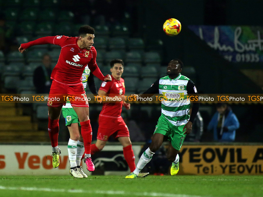 Daniel Powell of MK Dons heads the ball upfield during Yeovil Town vs MK Dons, Checkatrade Trophy Football at Huish Park on 6th December 2016