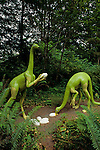 Prehistoric Gardens along the Oregon coast Struthiomimus stealing and eating eggs along tour trail Port Orford Oregon State USA
