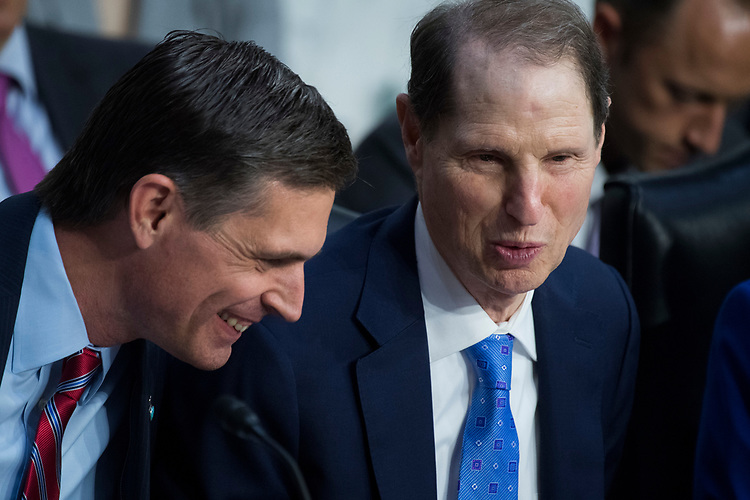 """UNITED STATES - AUGUST 01: Sens. Martin Heinrich, D-N.M., left, and Ron Wyden, D-Ore., attend a Senate (Select) Intelligence Committee hearing in Hart Building titled """"Foreign Influence on Social Media Platforms: Perspectives from Third-Party Social Media Experts,"""" on August 1, 2018. (Photo By Tom Williams/CQ Roll Call)"""