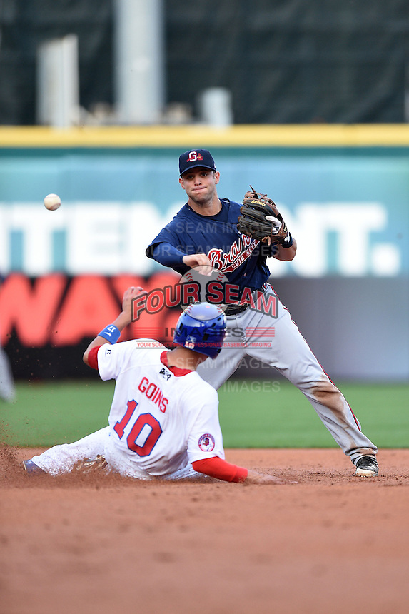 Gwinnett Braves second baseman Tommy La Stella (11) attempting to turn a double play as Ryan Goins (10) slides in during a game against the Buffalo Bisons on May 13, 2014 at Coca-Cola Field in Buffalo, New  York.  Gwinnett defeated Buffalo 3-2.  (Mike Janes/Four Seam Images)