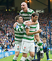 :: CELTIC'S JOE LEDLEY IS CONGRATULATED BY GARY HOOPER AND SCOTT BROWN AFTER HE SCORES THE FIRST FOR CELTIC  ::