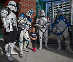 "Almost four-year-old Kadence poses with Storm Troopers during the Reno Aces ""Star Wars Night"" in Reno on Saturday, June 8, 2019."