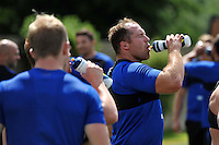 Henry Thomas of Bath Rugby has a drink. Bath Rugby training session on July 21, 2015 at Farleigh House in Bath, England. Photo by: Patrick Khachfe / Onside Images