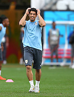 Luis Suarez of Uruguay looks dejected as he trains in the Arena Corinthians, Sao Paulo ahead of his sides Group D crunch fixture vs England tomorrow
