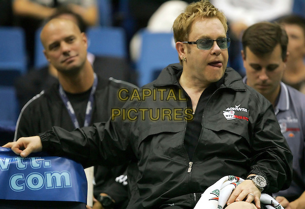 ELTON JOHN.The 14th Annual Advanta WTT Smash Hits held at The UC Irvince Bren Center in Irvine, California, USA..September 14th, 2006.Ref: DVS.half length black jacket tongue sunglasses shades.www.capitalpictures.com.sales@capitalpictures.com.©Debbie VanStory/Capital Pictures