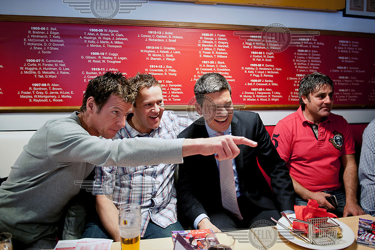 David Miliband with a group of Sunderland supporters in the Niall Quinn bar at Sunderland football club.
