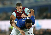 26th December 2019; Goodison Park, Liverpool, Merseyside, England; English Premier League Football, Everton versus Burnley; Chris Wood of Burnley tussles with Yerry Mina of Everton as they compete for the ball - Strictly Editorial Use Only. No use with unauthorized audio, video, data, fixture lists, club/league logos or 'live' services. Online in-match use limited to 120 images, no video emulation. No use in betting, games or single club/league/player publications