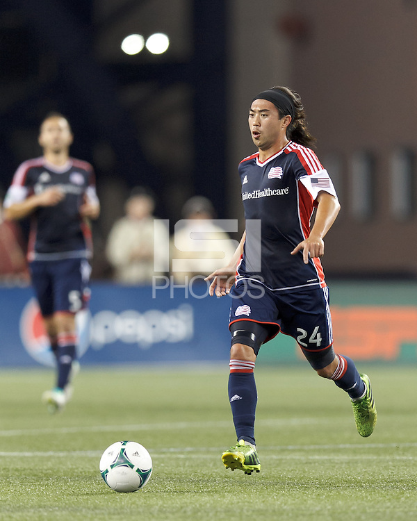 New England Revolution midfielder Lee Nguyen (24) brings the ball forward.  In a Major League Soccer (MLS) match, the New England Revolution (blue) defeated Chicago Fire (red), 2-0, at Gillette Stadium on August 17, 2013.