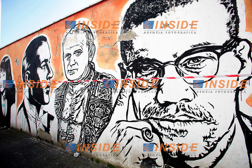 Title Wall of Fame, Artist  JB Rock, shown Rodolfo Valentino, John Paul II, Malcom X<br /> This is a 60 meters mural showing famous faces like the Hall of Fame<br /> Rome February 7th 2019. Street Art in Rome, Ostiense<br /> district. Very important writers painted Murales in various districts of Rome to tell stories about the city, to commemorate important moments, to embellish the quarter or simply to portray it.  <br /> Photo Samantha Zucchi Insidefoto