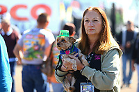 Mar 17, 2017; Gainesville , FL, USA; NHRA fan holds her dog as it wears a St Patricks day hat in the pits during qualifying for the Gatornationals at Gainesville Raceway. Mandatory Credit: Mark J. Rebilas-USA TODAY Sports