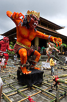 Ogoh-Ogoh sculpture (demon) Kala Bang (red), Pelihatan,  Ubud,  Central Bali. Balinese New Year called Nyepi (around march according to lunar calendar),  is a silent day of meditation and spiritual purification. One day before exorcist rituals are held for purification and balance of polar powers of the universe, first at noon by a priest (exorcism called Caru or Tawur Agung) and later on after sunset in a popular, carneval-like procession of Ogoh-Ogoh, symbolizing bhuta kali (demon, bad spirits,bad habits),  so all the bad spirits leave the village and the island.  Loud, rhythmic music and special performances are part of the procession called Ngerupuk. Road crossings are major spots of exorcism and special ogoh-ogoh performance, since demons often like to dwell here. At Nyepi, the following day, there is 24 hours silence, no vehicle or people on the street, no light or fire, no working - all the bad spirits should think, the island is abandoned and leave the island. Day after Nyepi is a day of reconciliation - new year starts purified.