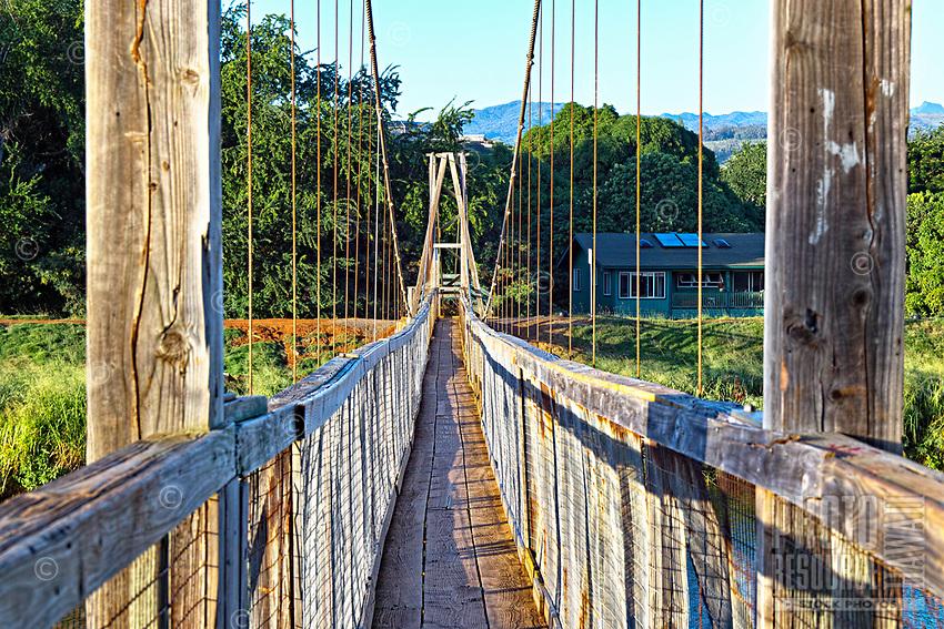 This swinging suspension bridge is a landmark tourist attraction in quaint Hanapepe, Kaua'i.