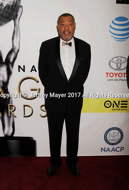 PASADENA, CA - FEBRUARY 11: Actor Laurence Fishburne arrives at the 48th NAACP Image Awards at Pasadena Civic Auditorium on February 11, 2017 in Pasadena, California.