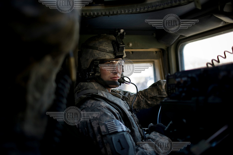 A soldier from F Company, 201st Brigade Support Battalion drives a Humvee during a convoy to Forward Operating Bases along the Pesh Valley. The unit often get attacked by Taliban fighters along this valley as they attempt to re-supply several bases in this pro-Taliban region, which sees some of the heaviest fighting in Afghanistan.