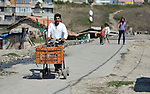 Demir Sandev is a Turkish-speaking Roma man who recycles scrap for a living, and here he pushes the cart he uses for his work through the Maxsuda neighborhood of Varna, Bulgaria.