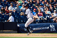 New York Yankees third baseman Oswaldo Cabrera (97) prepares to throw to first base during a Grapefruit League Spring Training game against the Toronto Blue Jays on February 25, 2019 at George M. Steinbrenner Field in Tampa, Florida.  Yankees defeated the Blue Jays 3-0.  (Mike Janes/Four Seam Images)