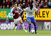 Cardiff City's Bruno Ecuele Manga under pressure from Burnley's Dwight McNeil<br /> <br /> Photographer Rich Linley/CameraSport<br /> <br /> The Premier League - Saturday 13th April 2019 - Burnley v Cardiff City - Turf Moor - Burnley<br /> <br /> World Copyright © 2019 CameraSport. All rights reserved. 43 Linden Ave. Countesthorpe. Leicester. England. LE8 5PG - Tel: +44 (0) 116 277 4147 - admin@camerasport.com - www.camerasport.com