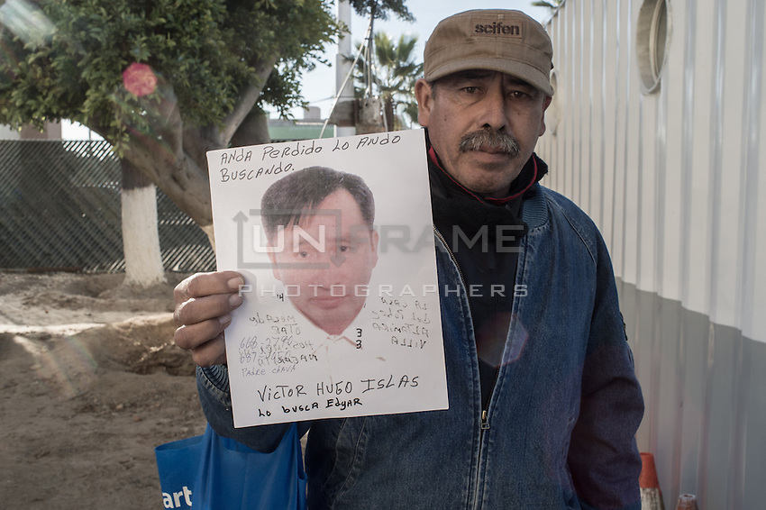 A Man is looking for his friend deported few weeks ago and went missing. Tijuana, Mexico. Jan 05, 2015.