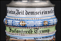 BNPS.co.uk (01202 558833)<br /> Pic: Ratisbons/BNPS<br /> <br /> 'Infantryman Trump'.<br /> <br /> An ornate beer stein that belonged to one of Donald Trump's German ancestor is being auctioned - suggesting that the famously teetotal Presidents relatives clearly liked a beer.<br /> <br /> The stein is inscribed to 'Infantryman Trump' as well as listing all the other members of his volunteer regiment in the Imperial army just prior to World War One.<br /> <br /> The Trump family was based in Kallstadt which is about 25 miles North of Landau, where the Regiment was based.