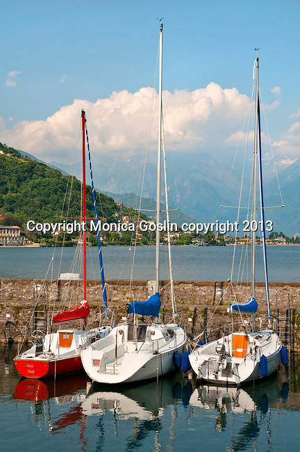 Boats and the view of Lake Como with the Italian Alps in the background; town of Gravedona, Italy