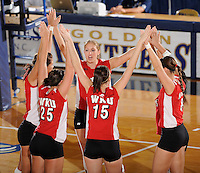 20 November 2008:  Western Kentucky middle hitter Megan Argabright (11, middle) and her teammates gather on the court prior to the WKU 3-0 victory over Denver in the first round of the Sun Belt Conference Championship tournament at FIU Stadium in Miami, Florida.