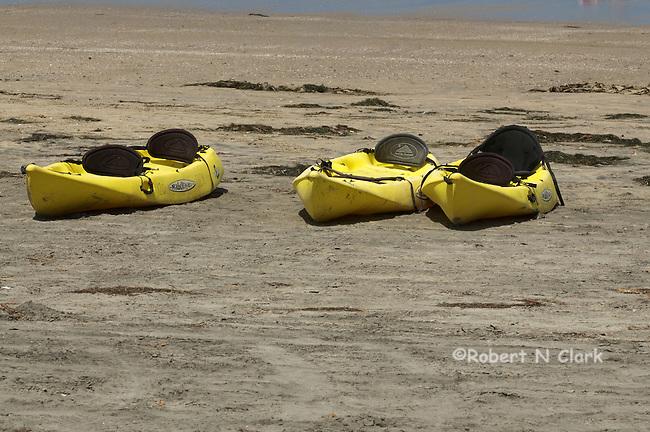 Kayaks waiting on the beach