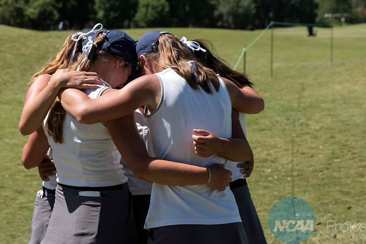HOUSTON, TX - MAY 12: Members of the George Fox University team huddle together during on the 18th green after placing second during the Division III Women's Golf Championship held at Bay Oaks Country Club on May 12, 2017 in Houston, Texas. (Photo by Rudy Gonzalez/NCAA Photos/NCAA Photos via Getty Images)