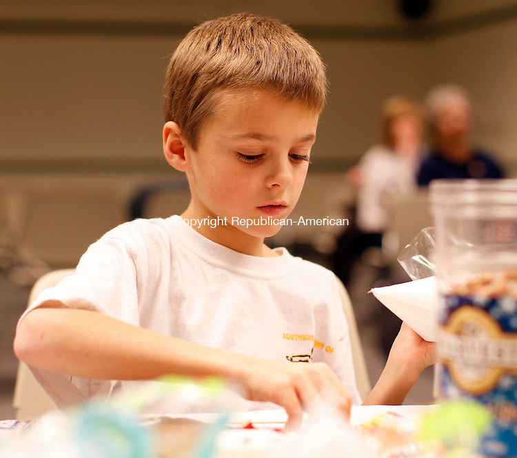 Southbury, CT- 10, December 2010-121010CM06  COUNTRY LIFE Aidan Markward, 8, of Southbury makes his gingerbread house at the Southbury Public Library.  Christopher Massa Republican-American