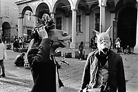 Italy. Emilia-Romagna Region. Bologna. Two students celebrate their university graduation by disguising themselves with horse and pig mask which cover their faces and heads. 29.10.2014 © 2014 Didier Ruef