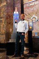 ESPN analyst and former men's national team defender Alexi Lalas poses for a photo next to a model of the Empire State Building lit in the Red White and Blue colors of the US Soccer Federation during the centennial celebration of U. S. Soccer in New York, NY, on April 05, 2013.